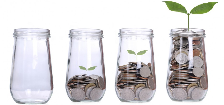 Coins and plant in a jar to signify savings growth